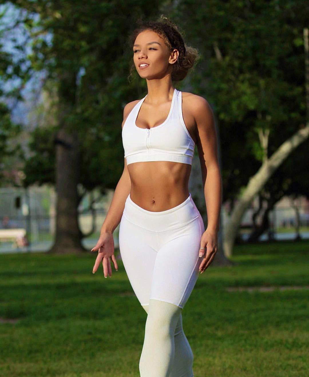 Woman in white yoga pants