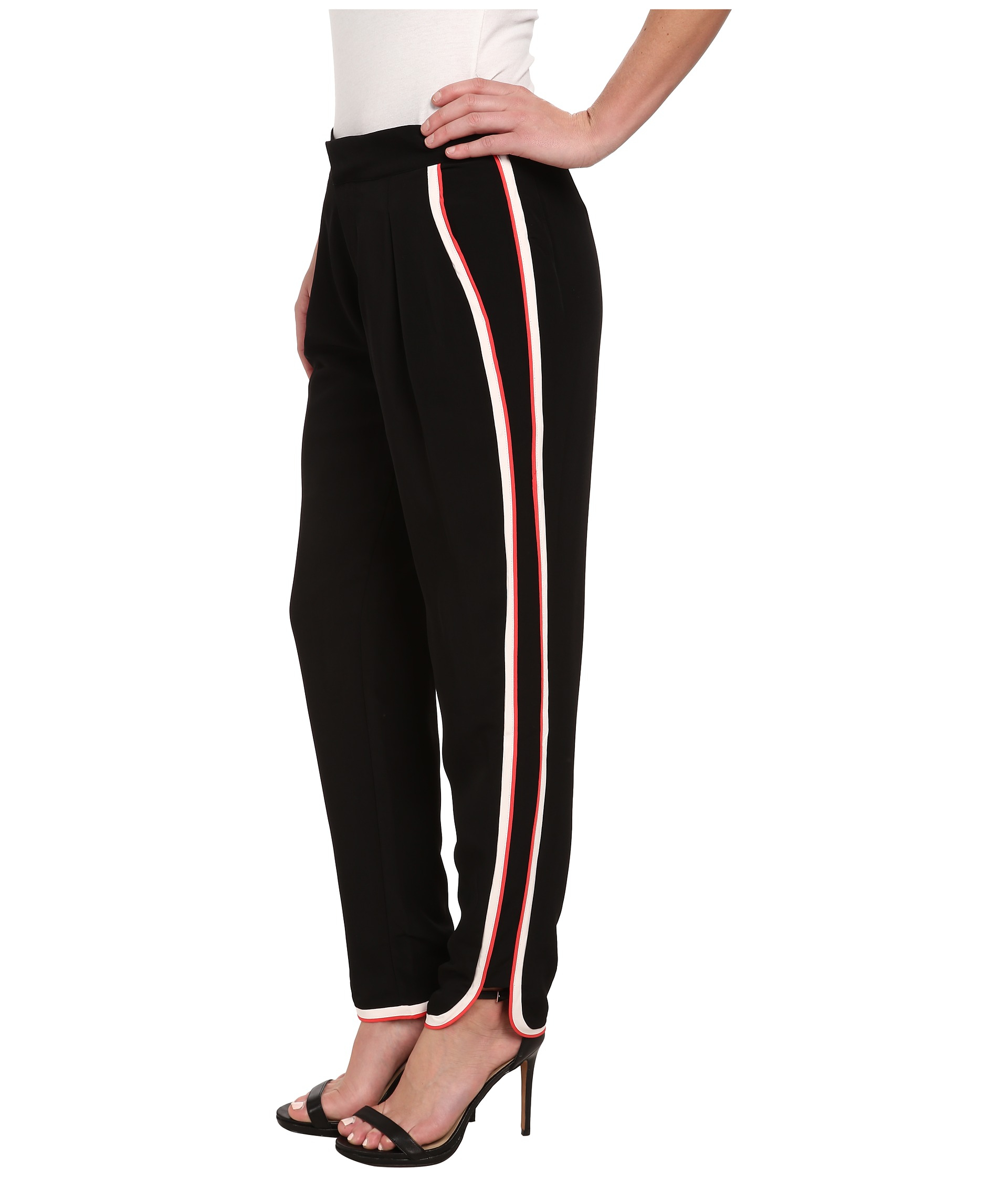 women s black pants with red pocket trim photo - 1